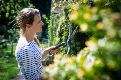 Gardener Katie Rushworth prunes her garden in spring
