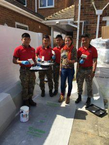 Katie Rushworth & Nepalese helpers lending a hand in the garden build of season 6, episode 3 if ITV's Love Your Garden