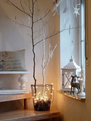 Branches with fairy lights in an alternative Christmas festive decoration for the home