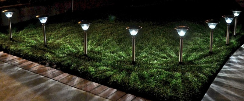 Solar powered garden lamps illuminate the garden at night time